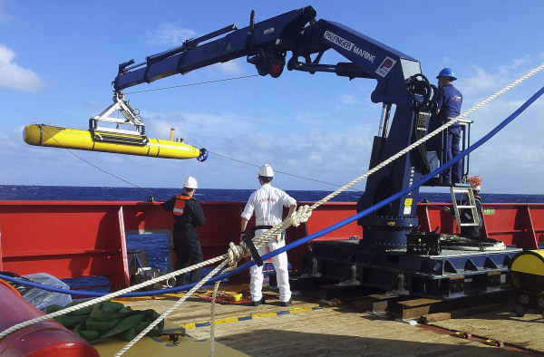 Image: The Bluefin 21 is hoisted back on board the Australian Defence Vessel Ocean Shield