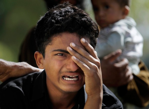 Image: A Pakistani boy mourns over the death of his family member, a victim of bomb blast, outside a morgue in a local hospital in Islamabad