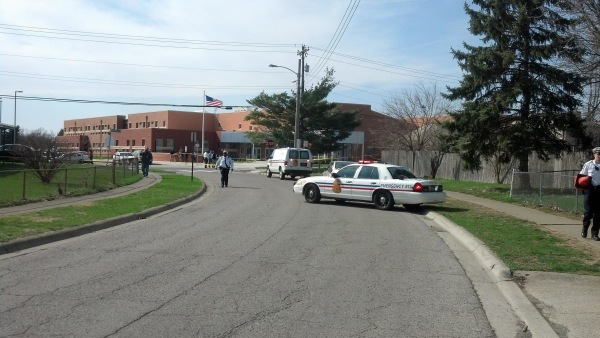 Image: Police officers investigate the scene where two people, including a 14-year-old boy, have been shot on the grounds of an elementary school in Columbus, Ohio