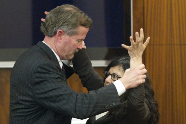 Image: Defense attorney Jack Carroll, left, and Ana Trujillo demonstrate the fight that led to a fatal stabbing as she testifies during the punishment phase of her trial