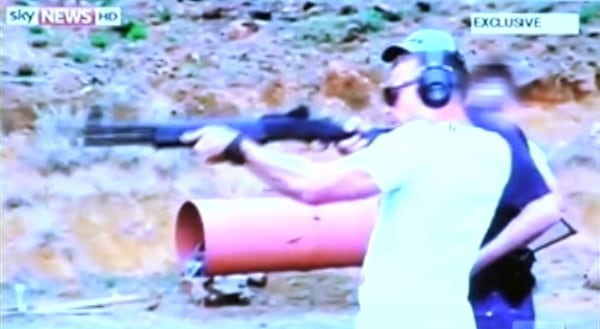 Image: Oscar Pistorius fires a weapon at a shooting range in a video shown to the court during his murder trial in Pretoria.