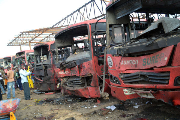 Image: Buses burnt after bombing in Abuja, Nigeria
