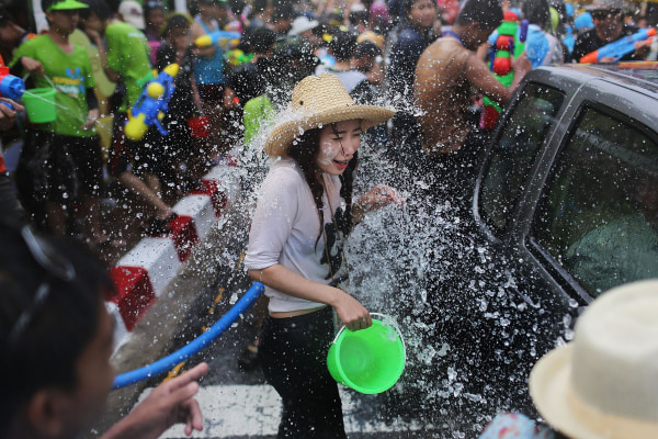 Image: Tourists and Thai residents take part in a city-wide water fight during the Songkran water festival