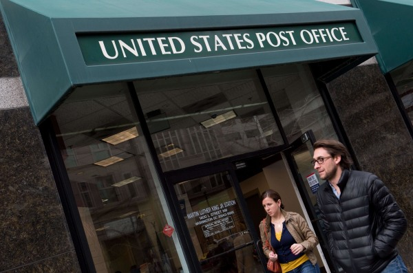 As more Americans file their tax returns electronically, fewer post offices are staying open later on April 15 for snail-mail filers.