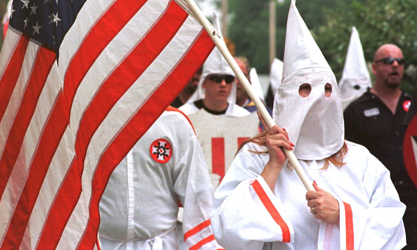 Image: Members of the Church of the American Knights of the Ku Klux Klan march