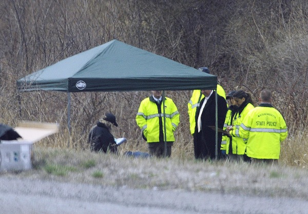 Image: Massachusetts State Police stand along Interstate 190 where police said a child's body was found near Sterling, Mass.