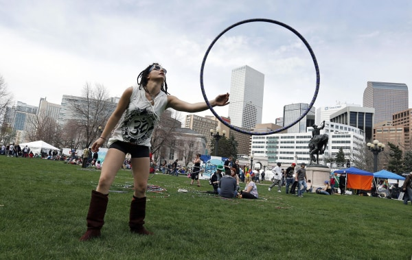 Image: Vanessa Vitali plays with a hoop at the annual 4/20 marijuana festival near downtown Denver at Civic Center Park