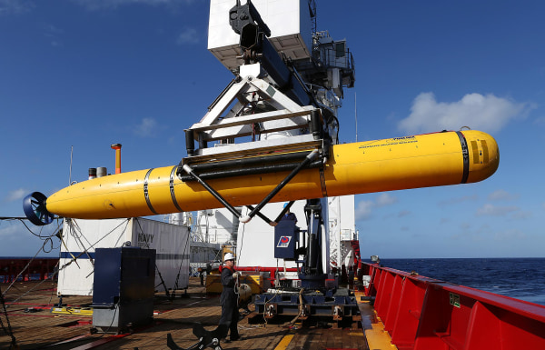 Image: The Phoenix International Autonomous Underwater Vehicle (AUV) Artemis is craned over the side of Australian Defence Vessel Ocean Shield