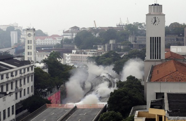 Image: Explosives are detonated to demolish part of the Perimetral overpass, as part of Rio's Porto Maravilha urbanisation project, in Rio de Janeiro