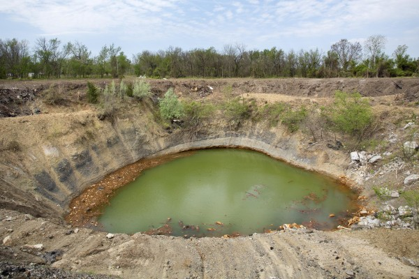 Image: A pond formed by a collapsed mine outside Picher