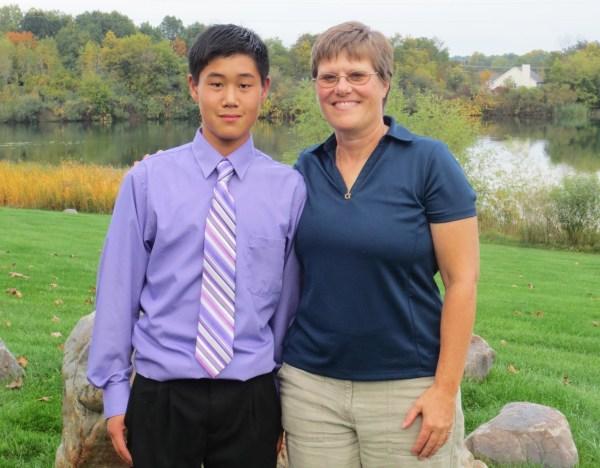 Image: Kris Snow with son Alex, 14