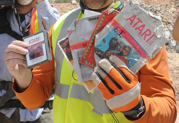 "Image: A worker shows the media the first recovered ""E.T. the Extra-Terrestrial"" cartridge at the old Alamogordo landfill in Alamogordo"