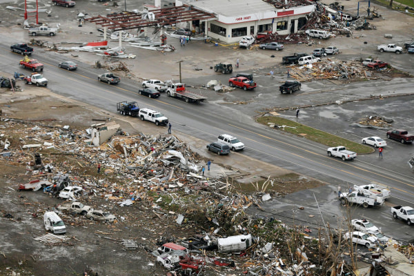 Image: Homes and businesses are wrecked in downton Vilonia, Ark.