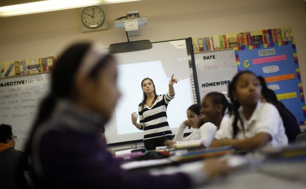 Image: Teacher Jaclyn Kruljac speaks to her students in 5th grade class at Walsh Elementary School in Chicago, Illinois