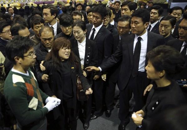 Image: South Korea's President Park meets a relative of a victim of sunken passenger ship Sewol