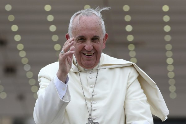 Image: Pope Francis waves as he leaves at the end of his weekly general audience at St. Peter's Square at the Vatican