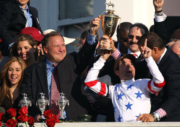 Kent Desormeaux (C), jockey for #20 Big Brown, celebrates with trainer Rick Dutrow (L of Desormeaux) after Big Brown won the 134th running of the Kentucky Derby on May 3, 2008 at Churchill Downs in Louisville, Kentucky.