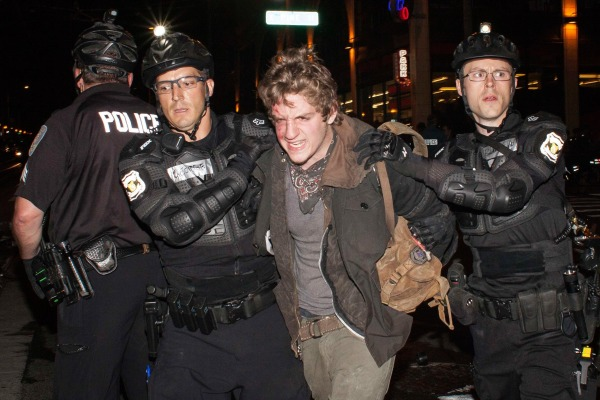 Image: Police detain a man during an anti-capitalist demonstration in Seattle, Washington