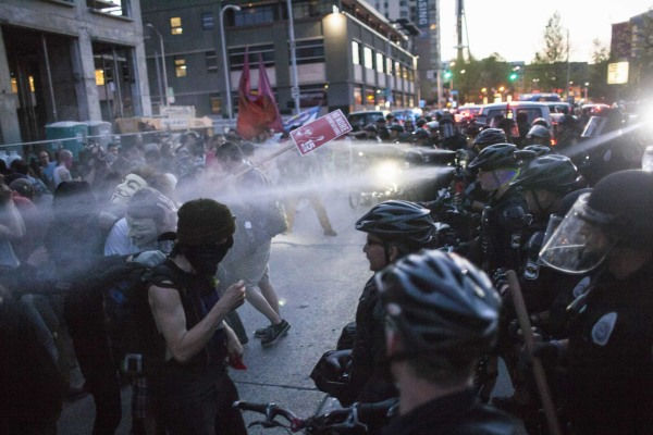 Image: Policemen target protestors with pepper spray during an anti-capitalist demonstration in Seattle, Washington