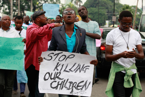 Image: People demonstrate during workers' day celebration in Lagos, Nigeria, May 1, calling on the government to rescue kidnapped schoolgirls.
