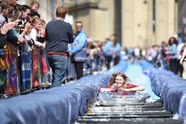 Image: A woman glides down a slide