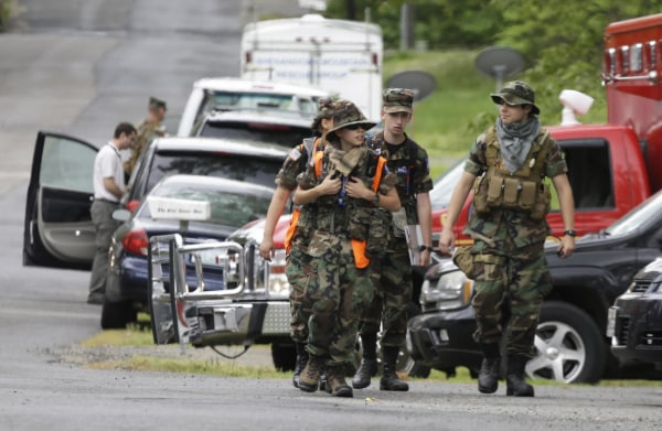 Image: Search teams arrives at a command post for the recovery efforts from a hot air balloon accident in Ruther Glen, Va., on May 10, 2014.