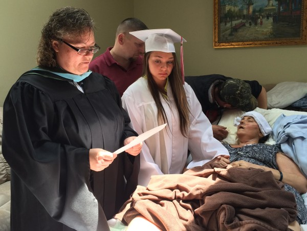 Image: Megan Sugg graduates at the bedside of her cancer-stricken mother, Darlene Sugg on Thursday.