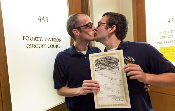 Image: Steven Gibson and Mark Hightower kiss after their marriage ceremony at the Pulaski County Courthouse in Little Rock