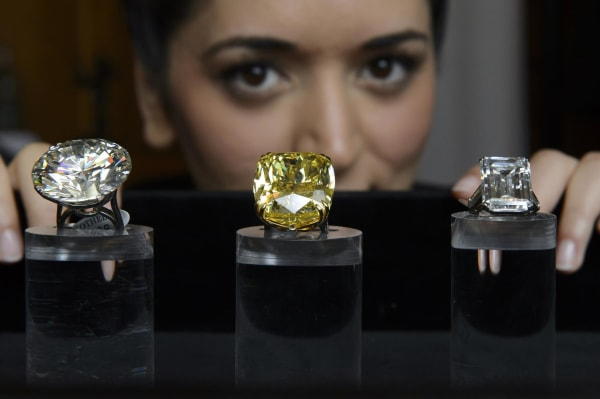 Image: Sotheby's sold a record $141.5 million in jewelry, including the highest amount ever paid for a yellow diamond.