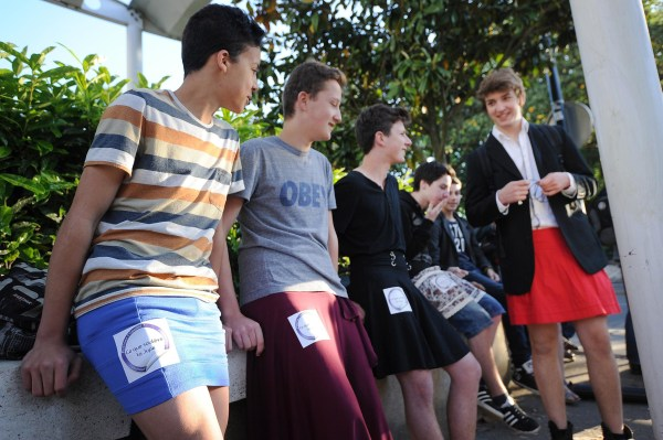 """Image: Students dress in skirts as part of the """"Ce que souleve la jupe"""" (""""What Raises the Skirt"""") campaign"""