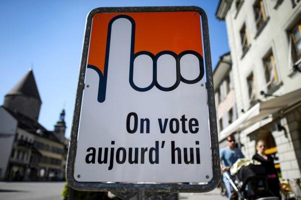 Image: Switzerland votes on minimum wage.