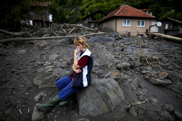 Image: Fata Kovacevic reacts near her flood-damaged house in Topcic Polje