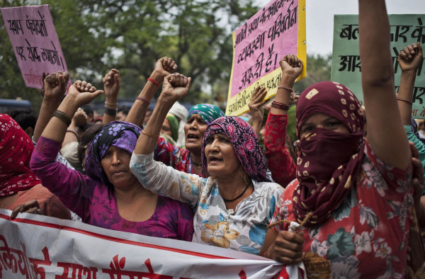 Image: Indian Dalit women shout slogans during a protest against a gang-rape of four Dalit girls