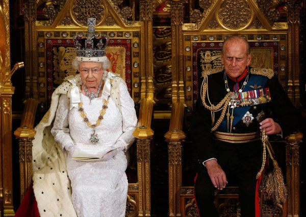 Image: Britain's Queen Elizabeth sits with Prince Philip as she delivers her speech in the House of Lords, during the State Opening of Parliament at the Palace of Westminster in London
