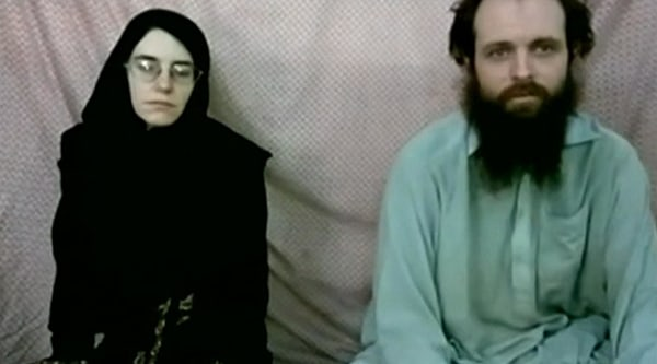Image: Caitlan Coleman and Joshua Boyle are seen in a still from a video made by the Taliban.
