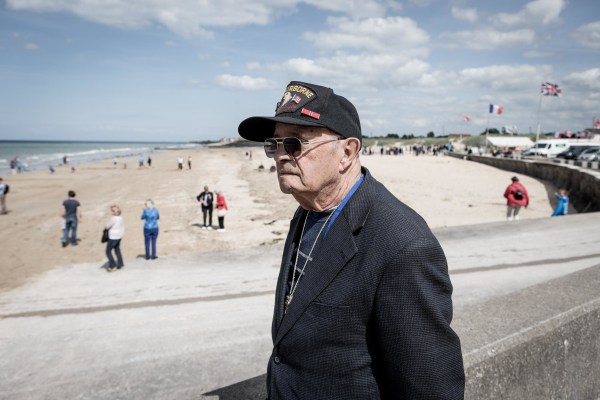 Image: U.S. veteran John Cipolla looks out onto Gold Beach in Normandy.