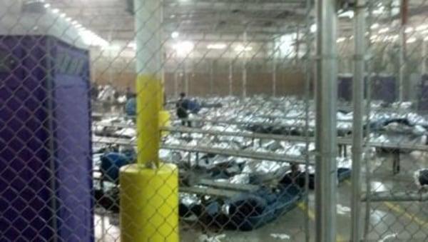 Image: Children resting under foil blankets at a Border Patrol facility in Nogales, Ariz.