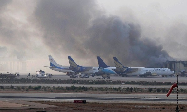 Image: Smoke rises after militants launched an early morning assault at Jinnah International Airport in Karachi