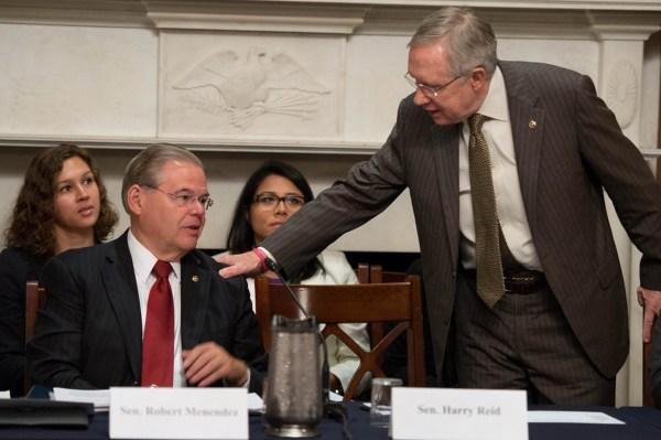 Sen. Robert Menendez, left, and Senate Majority Leader Harry Reid