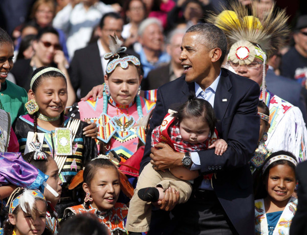 Image: U.S. President Obama holds a baby at Cannon Ball Flag Day Celebration in Standing Rock Sioux Reservation in North Dakota