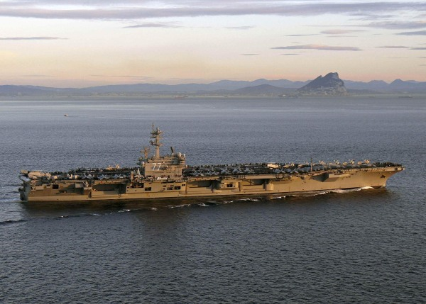 Image: Handout photo of aircraft carrier USS George H.W. Bush transiting the Strait of Gibraltar into the Mediterranean Sea