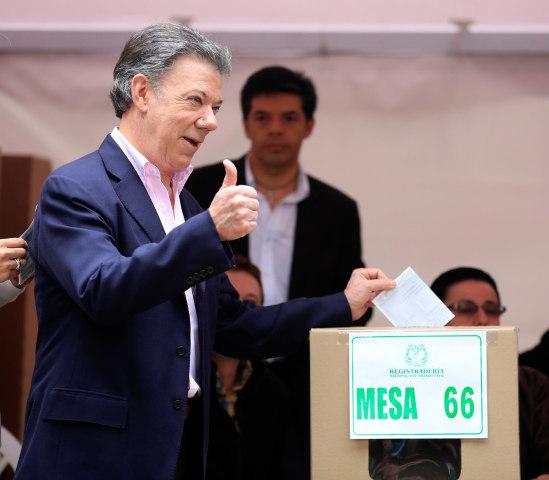 Image: President Juan Manuel Santos casts his vote in Bogota