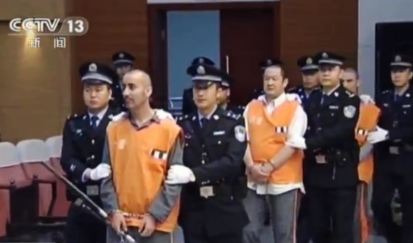 Image:  Prisoners are escorted into the Intermediate People's Court