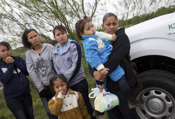 Image: U.S. Border Patrol agents detain a group of young migrants from Honduras and Guatemala