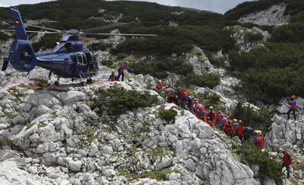 Image: Rescuers carry the stretcher with injured German cave researcher Johann Westhauser
