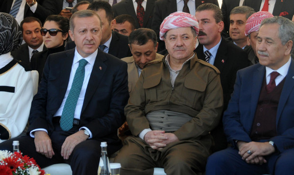 Image: Turkish Prime Minister Recep Tayyip Erdogan, left, and Iraqi Kurdish leader Massud Barzani, second right, attend a meeting on Nov. 16, 2013, in Diyarbakir, Turkey.