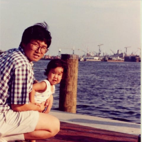 Jinna Yang as a baby, with her father, Jay Kwon Yang.
