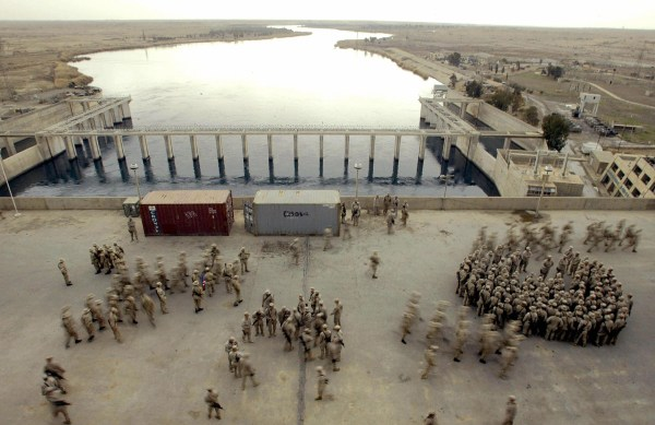 Image: U.S. Marines from the first Battalion 23rd Marines gather in the Haditha's dam deck 250 kms northwest from Baghdad on Feb. 19, 2005.