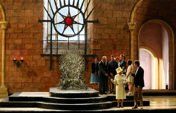 Image: Britain's Queen Elizabeth and Prince Philip talk with members of the cast on the set of the television show Game of Thrones in the Titanic Quarter of Belfast