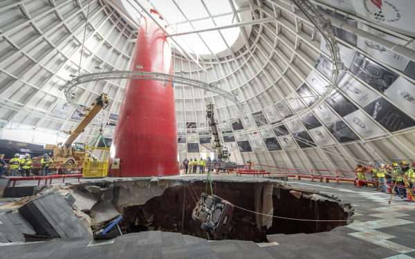 Image: Workers use a crane to extract the 1993 40th Anniversary Chevrolet Corvette from the sinkhole at the National Corvette Museum in Kentucky